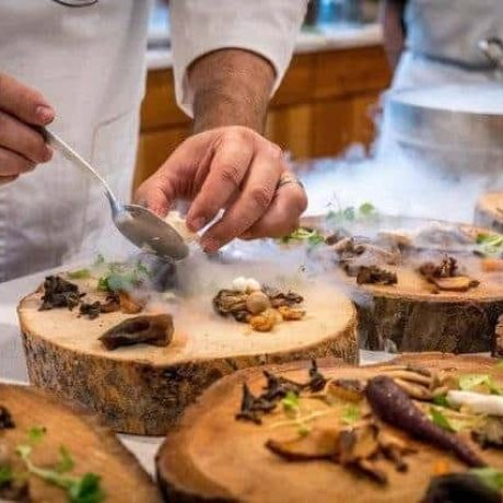 chef-preparing-vegetable-dish-on-tree-slab-1267320